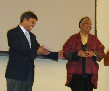 Dr. Edward Ramsamy presenting an award to Dr. Gayle Tate